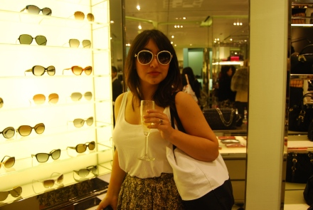 Me trying on Prada sunglasses in PRADA